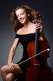 Joueur musical féminin sur le fond foncé Images libres de droits