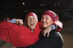 Joueurs d'hockey féminins. Photo stock