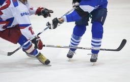 Joueurs d'hockey non identifiés Photographie stock