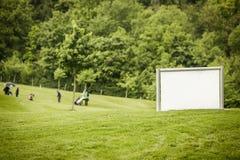 Joueurs de golf sur la cour Photographie stock libre de droits