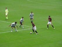 Joueurs de Milan dans l'action Photo stock