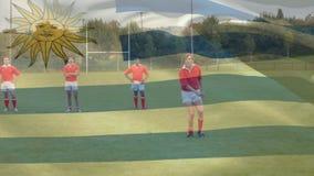 Joueurs de rugby courant avec le drapeau d'Uruguays clips vidéos