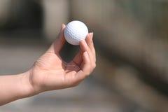 Jouez au golf sur la main Photos libres de droits