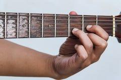 Jouez de guitare la version 10 à la main photos stock