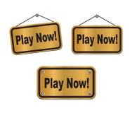 Jouez maintenant - signes en bronze Image libre de droits