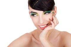 Joung妇女模型认为和微笑 库存照片