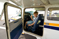 Joung boy in the pilot seat at Stock Photo