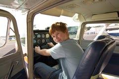 Joung pojke i den pilot- platsen på Royaltyfria Foton