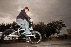 Joung red haired boy is jumping with his BMX Bike Royalty Free Stock Photography