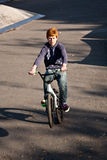Joung red haired boy jumps with his Royalty Free Stock Photography