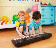 Jouons la musique Photos stock