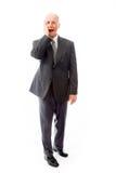 Jour d'homme d'affaires rêvant avec la main sur la joue Photographie stock libre de droits