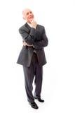 Jour d'homme d'affaires rêvant avec la main sur le menton Image stock