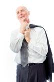 Jour d'homme d'affaires rêvant avec la main sur le menton Images stock