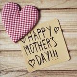 Jour de mères heureux des textes dans une note Image stock