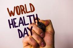 Jour de santé du monde des textes d'écriture de Word Le concept d'affaires pour la date spéciale pour des activités saines s'inqu Photos stock