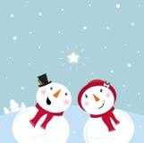 Jour de Valentine´s : Bonhomme de neige et neige - femme Image stock
