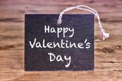 Jour de valentines heureux écrit sur le panneau de craie Images libres de droits