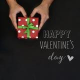 Jour de valentines heureux de cadeau et de textes Images stock