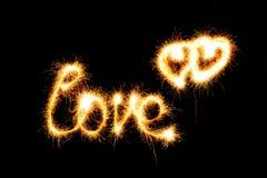 Jour de valentines - l'amour a fait un cierge magique sur le noir Images stock