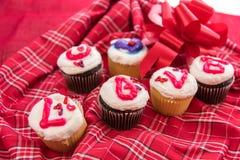 Jour de valentines - petits gâteaux orthographiant l'AMOUR Images libres de droits