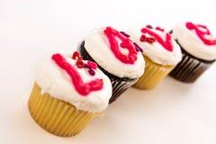 Jour de valentines - petits gâteaux orthographiant l'AMOUR Photos libres de droits