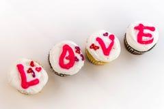 Jour de valentines - petits gâteaux orthographiant l'AMOUR Image libre de droits