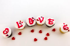 Jour de valentines - petits gâteaux orthographiant l'AMOUR Photo stock