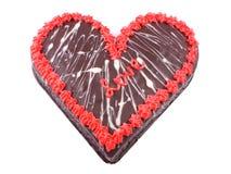 Jour du ` s de Valentine, gâteau de chocolat sous forme de coeur avec l'amour de mot Photographie stock