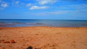 Jour ensoleillé de plage Photos libres de droits