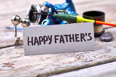 Jour et articles de pêche du ` s de père Image stock