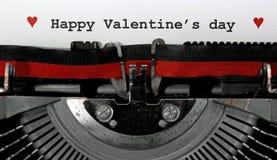 Jour heureux de Valentine s des textes larges écrit avec la vieille machine à écrire Photographie stock