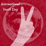 Jour international de la jeunesse 12 août signe de V, victoire de signe de main Fond grunge rouge Photos stock