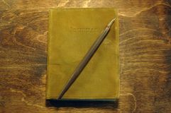 Daily Journal. Leather bound journal with fountain pen Stock Photography