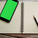 Journal book and smart phone photo stock Stock Images