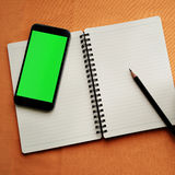Journal book and smart phone photo stock Royalty Free Stock Image