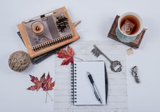 Journal Books, Candle, and Tea Scene royalty free stock images