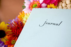 Journal with colorful flowers Royalty Free Stock Photos