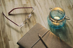Journal, glasses and an old candle lantern Royalty Free Stock Image