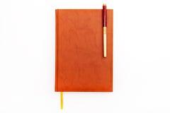 Journal intime et stylo d'isolement sur le blanc Image libre de droits