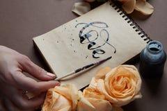 Journal intime ou carnet avec amour de mot Images stock