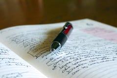 Journal intime - rapports de chaque jour L'habitude de beaucoup de personnes photos stock