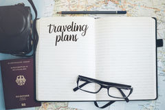 Journal on maps with passport and camera royalty free stock images