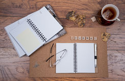 Journal Scene with Open Journal Books and Tea royalty free stock image