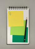 Journal with yellow and green sticky notes. And pencil from above - space for text Royalty Free Stock Photography