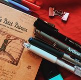 Journal. Ing tools and equipment such as pens, clips, and a notebook royalty free stock images