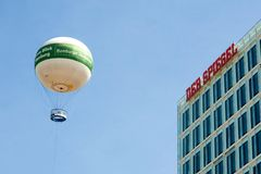"Journalism. Hot-air-balloon with the Label ""Hamburger Abendblatt"" in front of the publishing-building of ""Der Spiegel Stock Image"