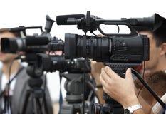 Journalisme d'appareil-photo de conférence d'affaires Images libres de droits
