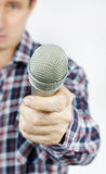 Journalist asks a question and holding the microphone. On light background Stock Photo
