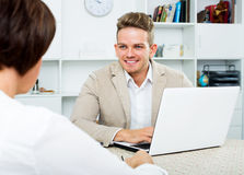 Journalist communicates with the wealthy woman. Male journalist communicates with the cheerful wealthy women in an informal situation Stock Images
